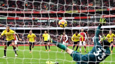 Troy Deeney of Watford sees his penalty saved by Petr Cech of Arsenal