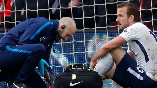 Harry Kane gets treatment after injuring his ankle.