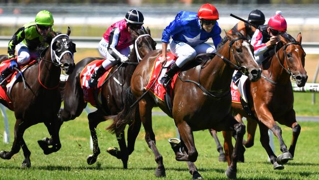 Jockey Billy Egan riding Zizzis wins the Magic Millions Adelaide 2YO Classic at Morphettville. Picture: David Mariuz/AAP