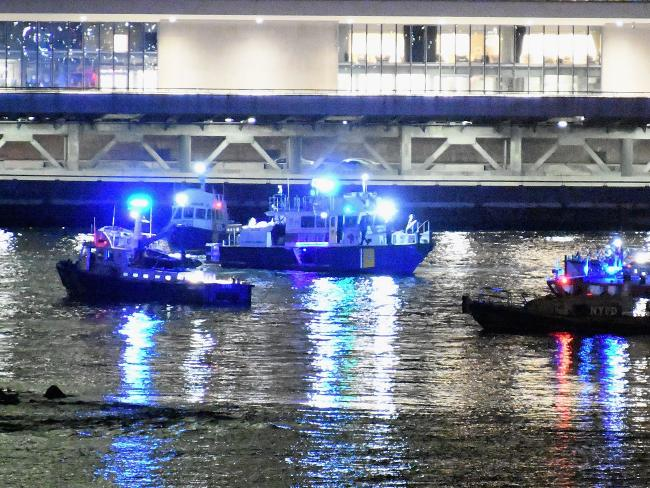 Emergency responders work at the scene of a helicopter crash in the East River. Picture: Getty