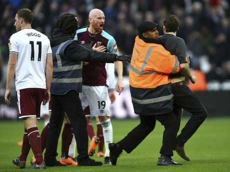 A Pitch invader is seized by security staff