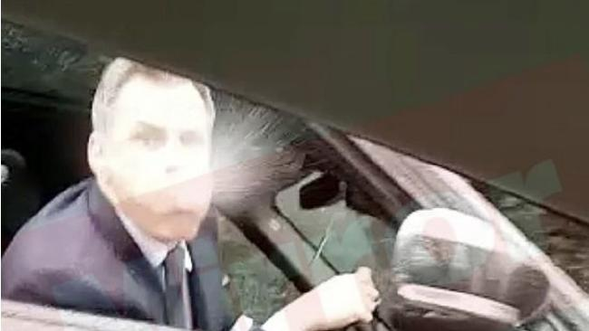 Jamie Carragher has been caught spitting at a pair of Manchester United fans in a shocking viral video
