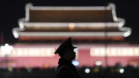 A paramilitary police officer stands guard in Tiananmen Square after Mr Xi secured a path to rule indefinitely. Picture: Greg Baker/AFP