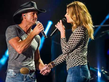 Country husband and wife duo, Tim McGraw and Faith Hill. Hill made the decision for McGraw to not finish the concert. Picture: Splash