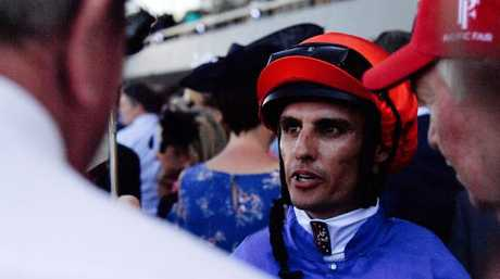 Jockey Billy Egan talks to connections after his winning ride.