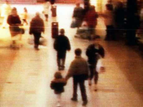 A surveillance camera shows the abduction of two-year-old James Bulger, pictured holding the hand of Jon Venables in a Liverpool shopping mall on February 12, 1993 at 3:42pm. Picture: BWP Media via Getty Images