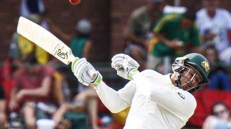 Australia's Usman Khawaja evades a short ball.