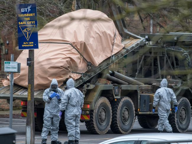 Military personnel wearing protective suits continue investigations into the poisoning of Sergei Skripal in Salisbury, England. Picture: Getty Images