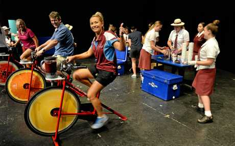 Head of HPE at St Marys College Louise McCarthy makes a smoothie with a bicycle as part of a school fundraiser on Tuesday.