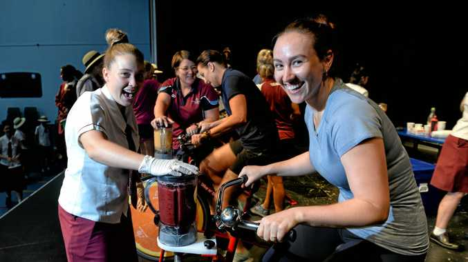 GRUELLING CHALLENGE: St Mary's staff try out the Bike n' Blend machines to raise money for Caritas.