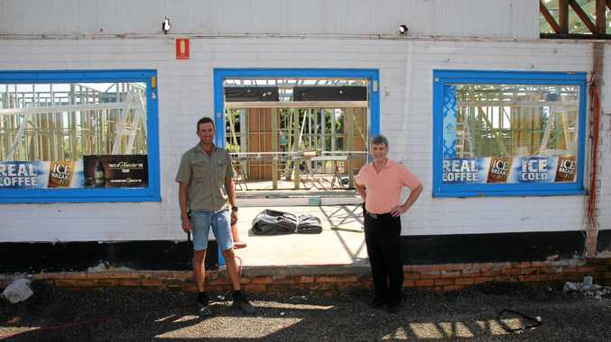 ON ITS WAY: Ross McPhee, right, stands with builder John Fazackerley out front of Rusty's fuel station.