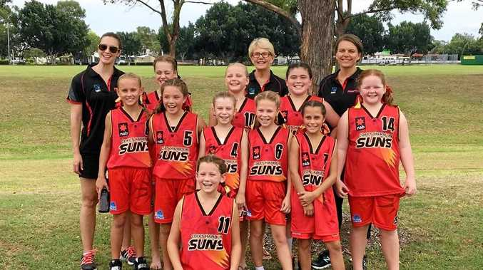 The Coffs Harbour Suns' under-12 Girls Division 1 team coached by Cristi Juffermans (back right).