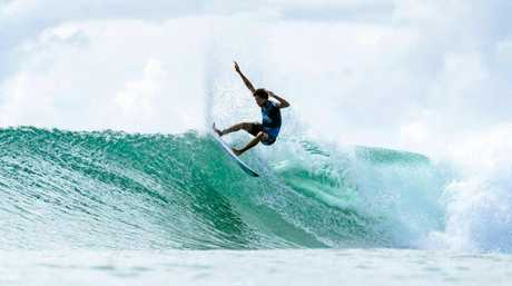 Mikey February of South Africa won heat 3 of round 2 of the Quiksilver Pro at Snapper Rocks.