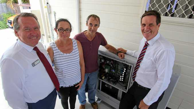 POWER: Jim Madden, homeowners Vanessa and Warren Rhodes with Emergy Minister Anthony Lynham and the home battery system.