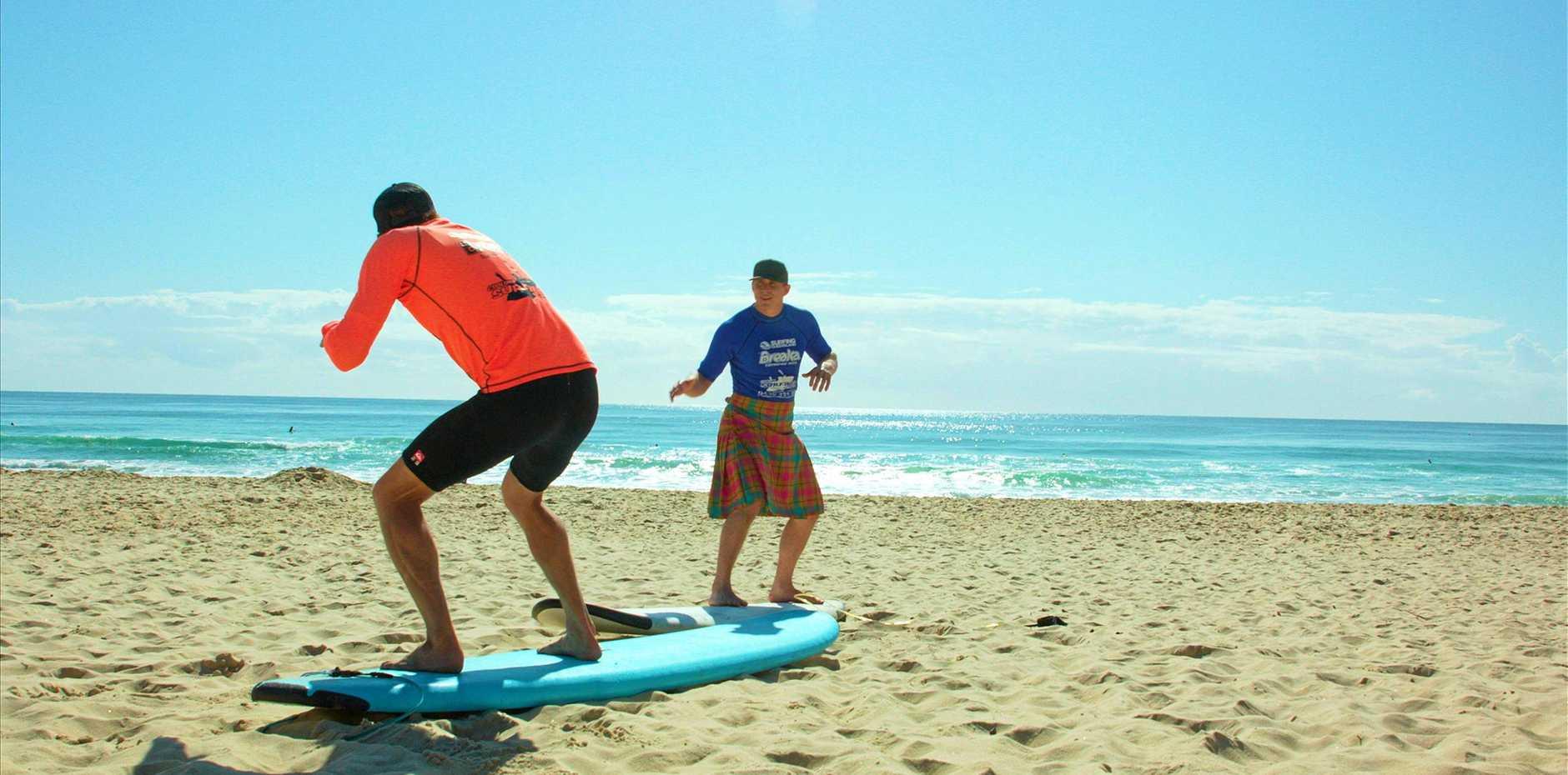 Euan Burton learns how to surf on the Sunshine Coast.