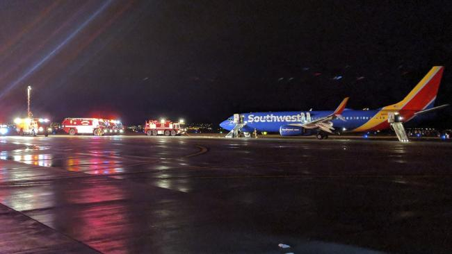 Passenger leapt from the wing of a Southwest flight after an emergency landing in the US. Picture: David Fleck via AP