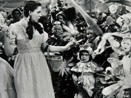 Garland and some of the actors who played the munchkins in the iconic film.