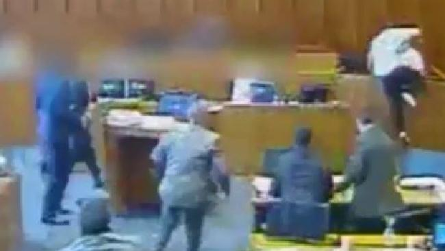 Dramatic footage has been released of a Crips gang member being shot dead in court after attacking a witness. Picture: CCTV / The Sun