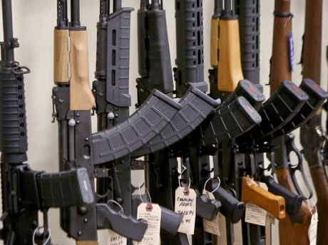 A portion of the rack displaying various models of semiautomatic sporting rifles is seen at Duke's Sport Shop in New Castle, Pa. Picture: AP Photo/Keith Srakocic