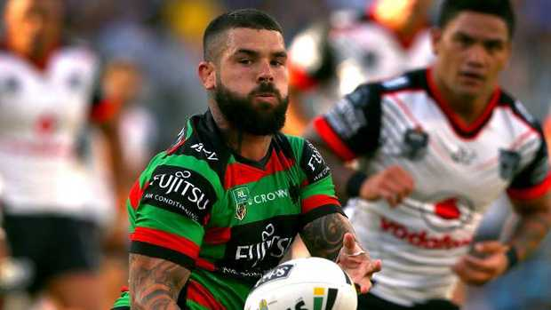 Adam Reynolds of the Rabbitohs passes the ball.
