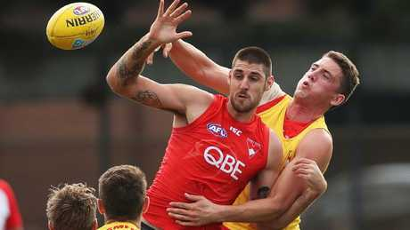 Sam Naismith (front) did his ACL at training and Darcy Cameron (back) could become the Swans' No.1 ruckman. Picture: Phil Hillyard