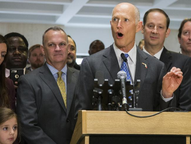 Florida Gov. Rick Scott signed a bill to increase the age limit for purchasing firearms to 21, but was sued by the NRA. Picture: AP Photo/Mark Wallheiser