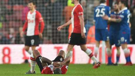 Southampton's Gabonese midfielder Mario Lemina (L) and players react at the final whistle during the English Premier League football match between Southampton and Stoke City