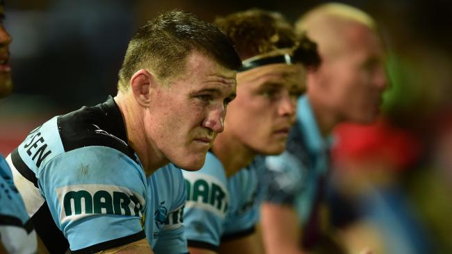 Sharks captain Paul Gallen looks on.