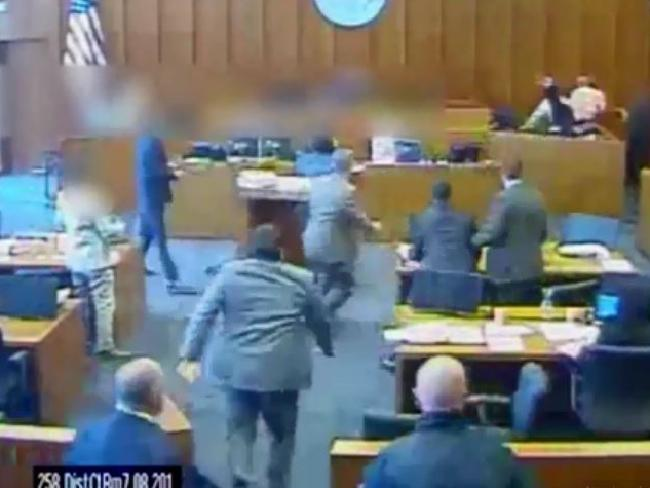 Crips gang member falls into the witness stand after being shot multiple times by court marshall. Picture: CCTV / The Sun