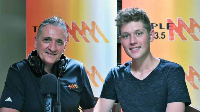 New USC Journalism student Liam Bland with his father Andrew. The 2017 Fraser Coast Anglican College captain had the inside track on university life when he started his degree last month thanks to the Headstart program.