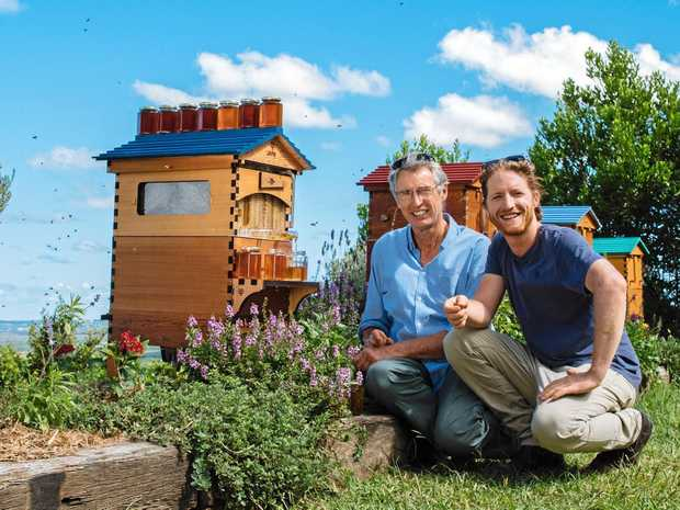 Flow Hive co-inventors father and son Stuart and Cedar Anderson with an updated version of their multiple award-winning Flow Hive the Flow Hive 2.