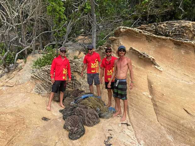TEAM CLEAN: Michael Whelan, Mark Huston, Tony Young and Sean Roll; with the ghost neT salvaged from Hook Passage.