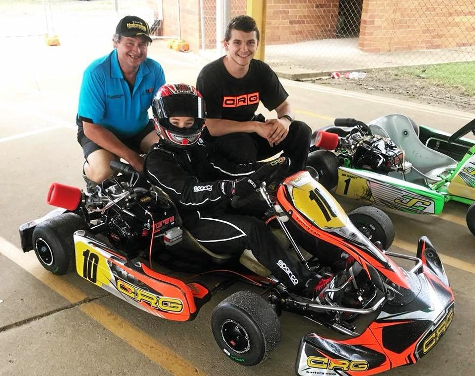 Supercar driver Todd Hazelwood (right) gives some advice to his partner Alice Litzow before she drives off in the kart. Joining the duo is Richard Litzow.
