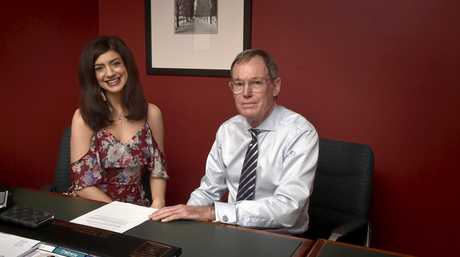 FIRST SURGERY: Katanya Watherston, with Dr John Esler, was recently diagnosed with bowel cancer and will undergo a Toowoomba-first procedure to preserve her fertility.