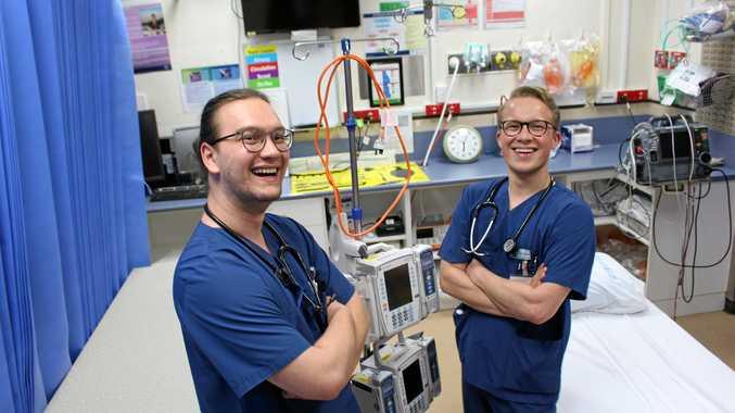 SCRUBBING UP: German medical students Sam Jeske and Julian Zieler looking sharp in their crisp blue scrubs at Warwick Hospital.