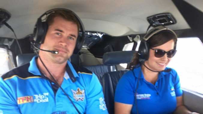 Titans ambassador Brenton Lawrence prepares for takeoff over the Great Barrier Reef