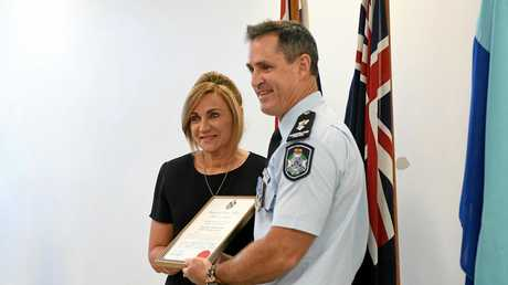POLICE AWARDS CEREMONY: Edon Place's Lyn Booth receiving an award from Superintendent Craig Hawkins.