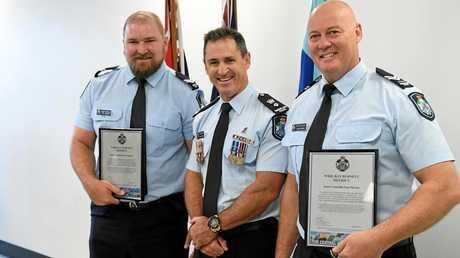 POLICE AWARDS CEREMONY: Senior Constable Paul Jackson and Senior Constable Sean Macrae receiving an award from Superintendent Craig Hawkins.