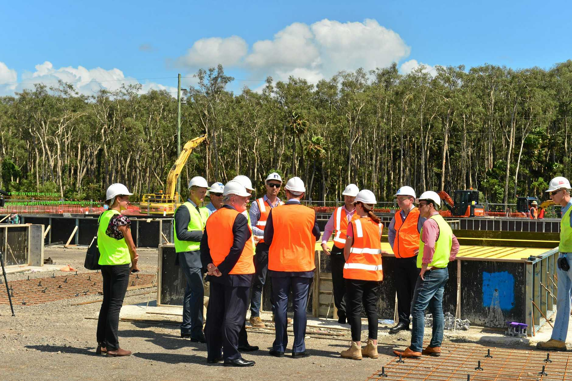 Stockland executives, politicians and construction company staff tour the Birtinya Town Centre site.