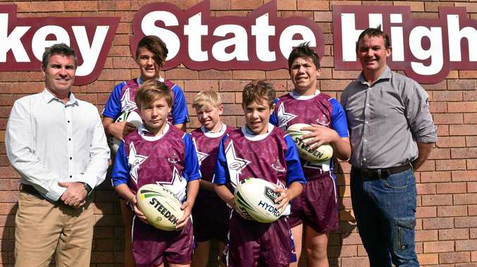 FRESH LOOK: Unveiling Oakey State High School's new jerseys are (from left) principal Danny Keenen, Carson Prior-Mead, Jack Merrell, Fletcher Voll, Darcy Watherston, Lennox Kirby and Neville Cherry.