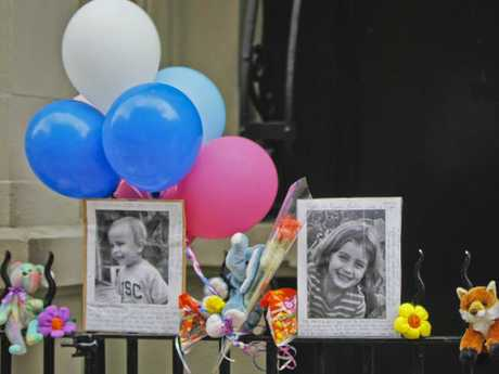 Photographs of six-year-old Lucia Krim and her two-year-old brother, Leo, are displayed alongside balloons and stuffed animals at a memorial outside the apartment building where they lived in New York. Picture: AP