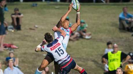 Israel Folau leaps over Rebels fullback Dane Haylett-Petty to score during a trial. of the Rebels. Picture: RUGBY.com.au/Stuart Walmsley