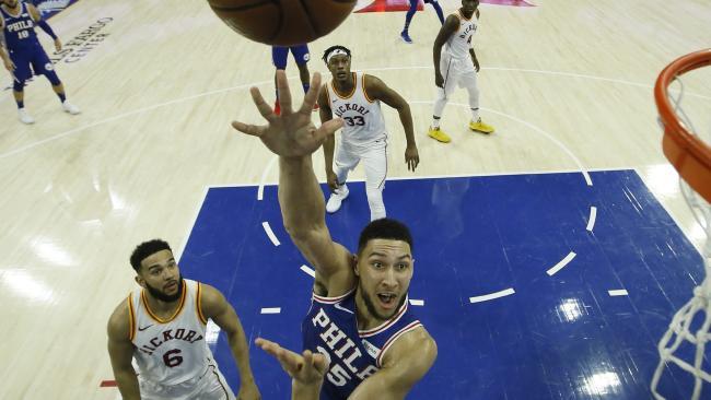 Ben Simmons puts up a jump hook as Cory Joseph watches on. (AP Photo/Matt Slocum)