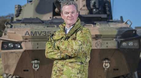 Defence Industry Minister Christopher Pyne attends testing of the shortlisted vehicles in Queensland.