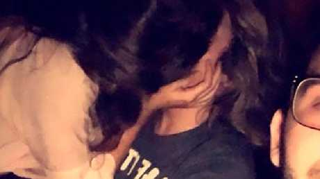 A man took a selfie of the moment his cheating girlfriend passionately kissed another guy at a party