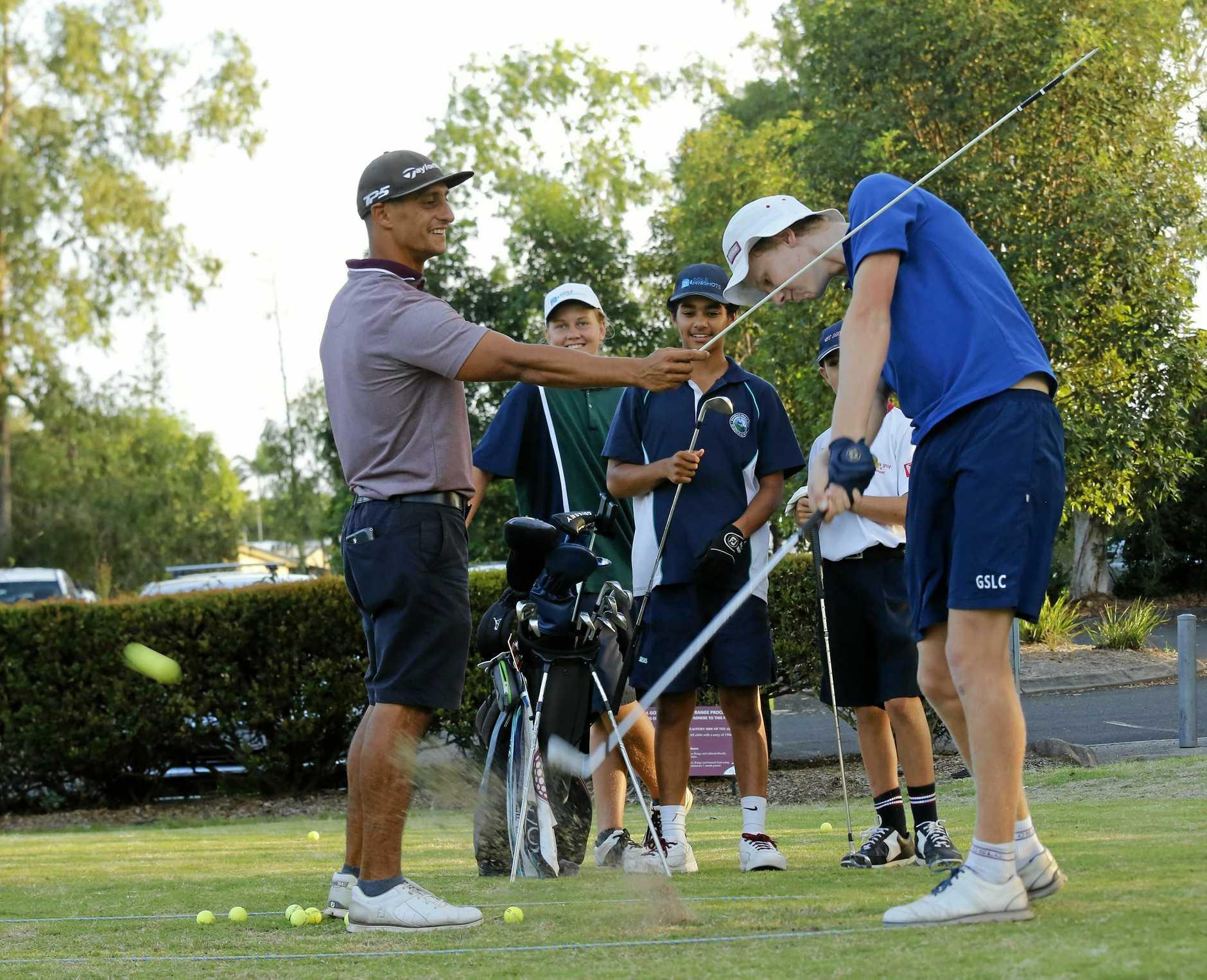 TEE OFF: Noosa Golf Club coach Jimmy Douris with Noosa Juniors