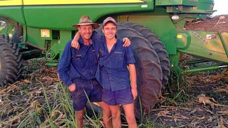 TIGHT BOND: Forest Hill farmer Mitch Brimblecombe, with father Linton, spent a year farming in Uganda.