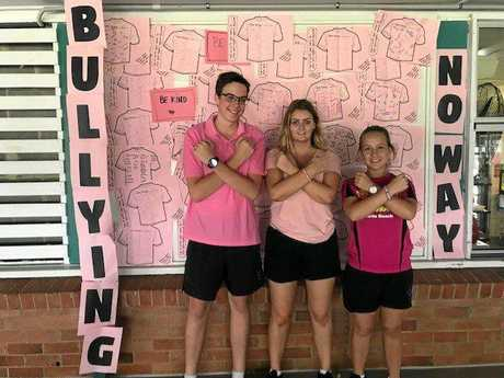 School captains Darcy Larkin, Porsha Hancock and Tayla Goody at anti-bullying, Pink Shirt Day 2018 on Tuesday.