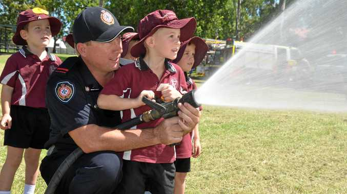 Local emergency services personnel pay a visit to the kids at Monto State School.