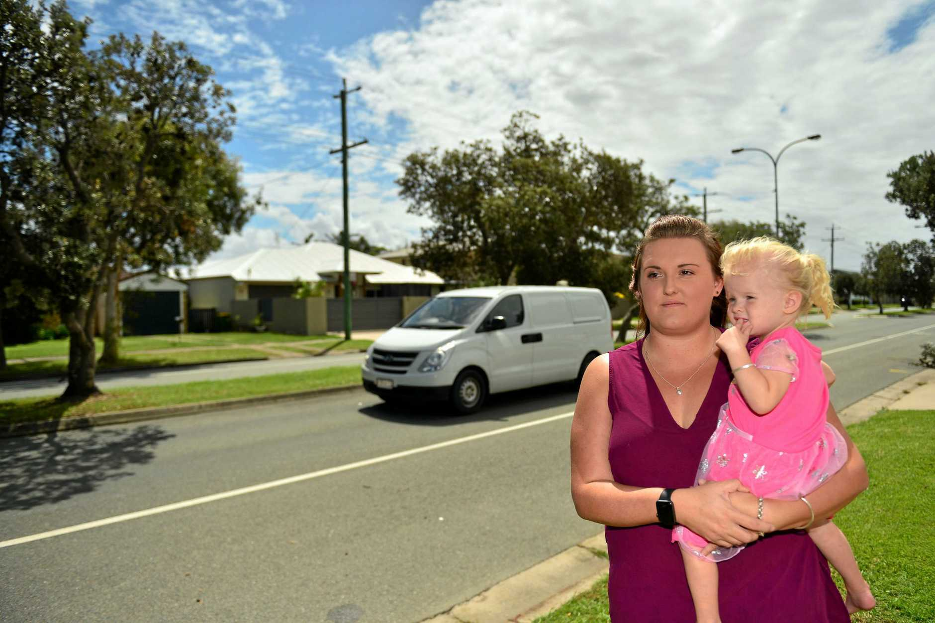 Jessica Clee and her daughter Peyton Unman outside their home in Point Cartwright Drive where a trailer was stolen.